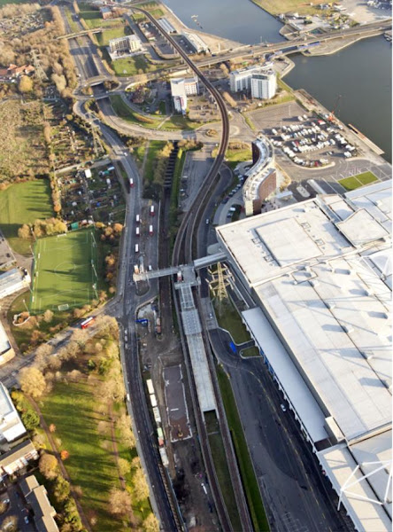 Aerial view of Custom House Station (Crossrail to left, existing DLR to right) looking east towards Connaught Tunnel