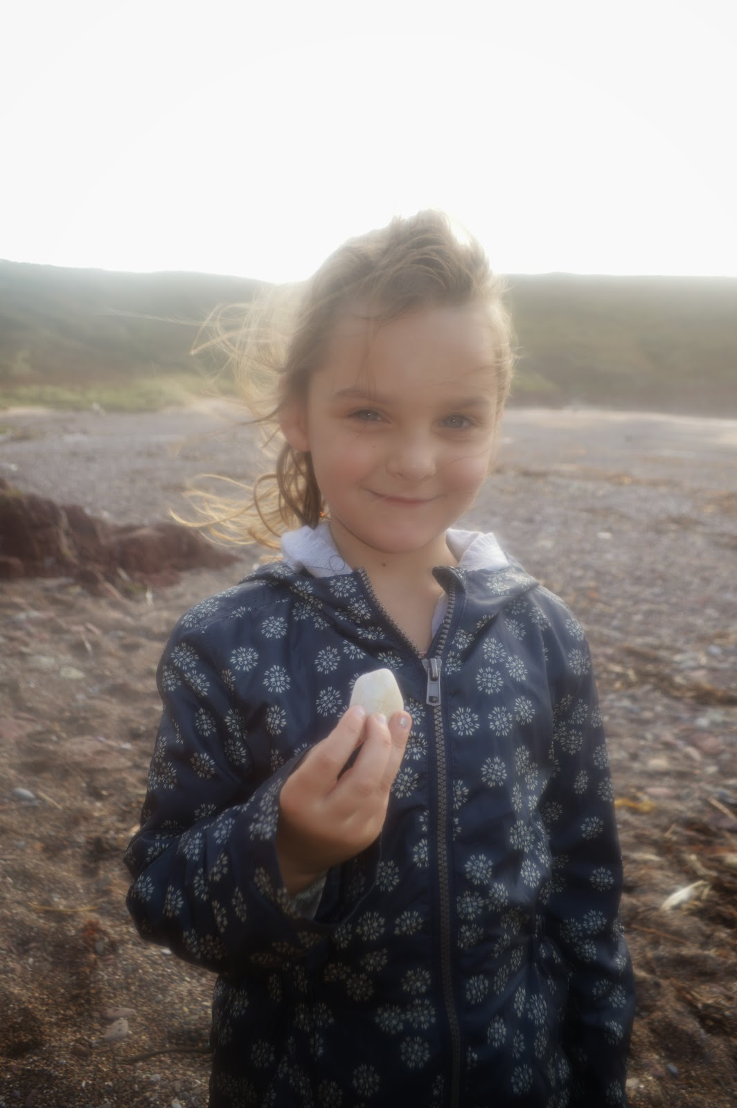 Caitlyn with Pebble at manorbier Beach Pembrokeshire Wales
