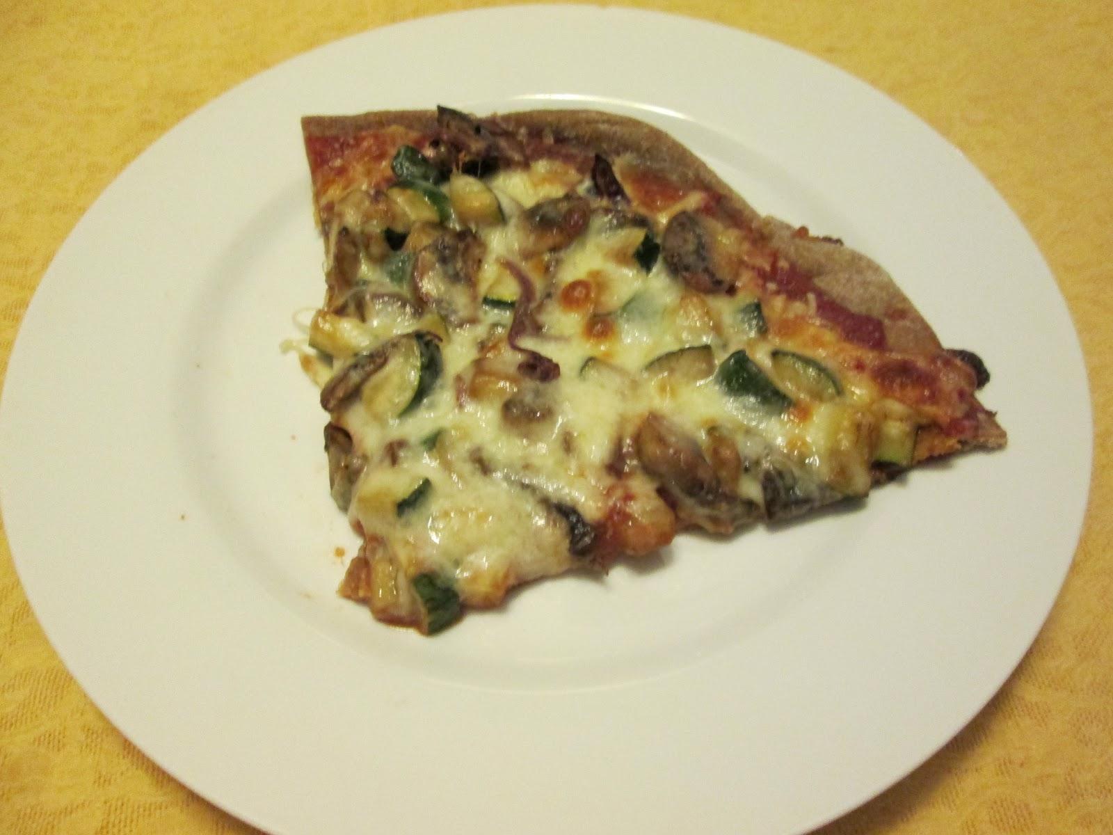 large slice of Whole Wheat Veggie Pizza