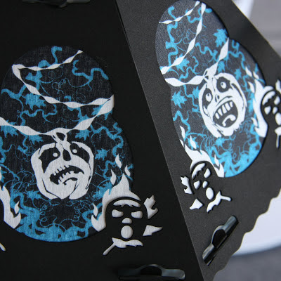 Close-up photo of 2 panels of a vintage styled Halloween lantern by Bindlegrim from 2012