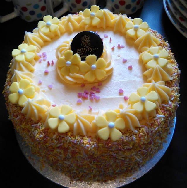 lemon butter cream cake with pretty  yellow flowers