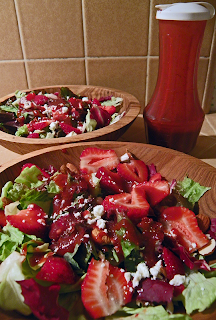Two bowls of salad with dressing on the side