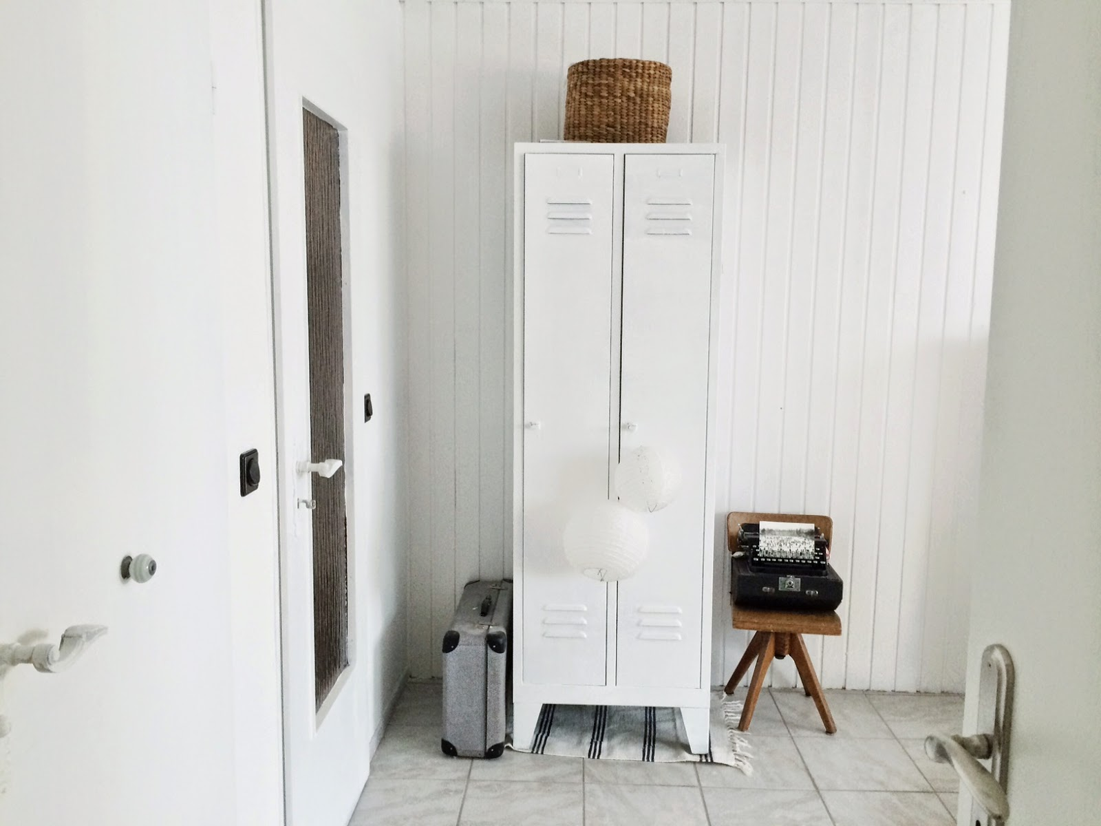 white walls and vintage pieces