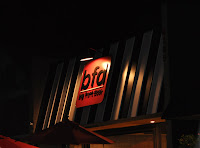 photo of big front door (bfd) store front by evening