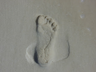 footprint in sand moving forward