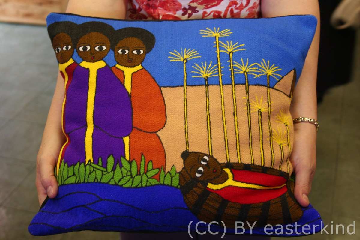 pillow illustrating the story of Moses in the Bulrushes