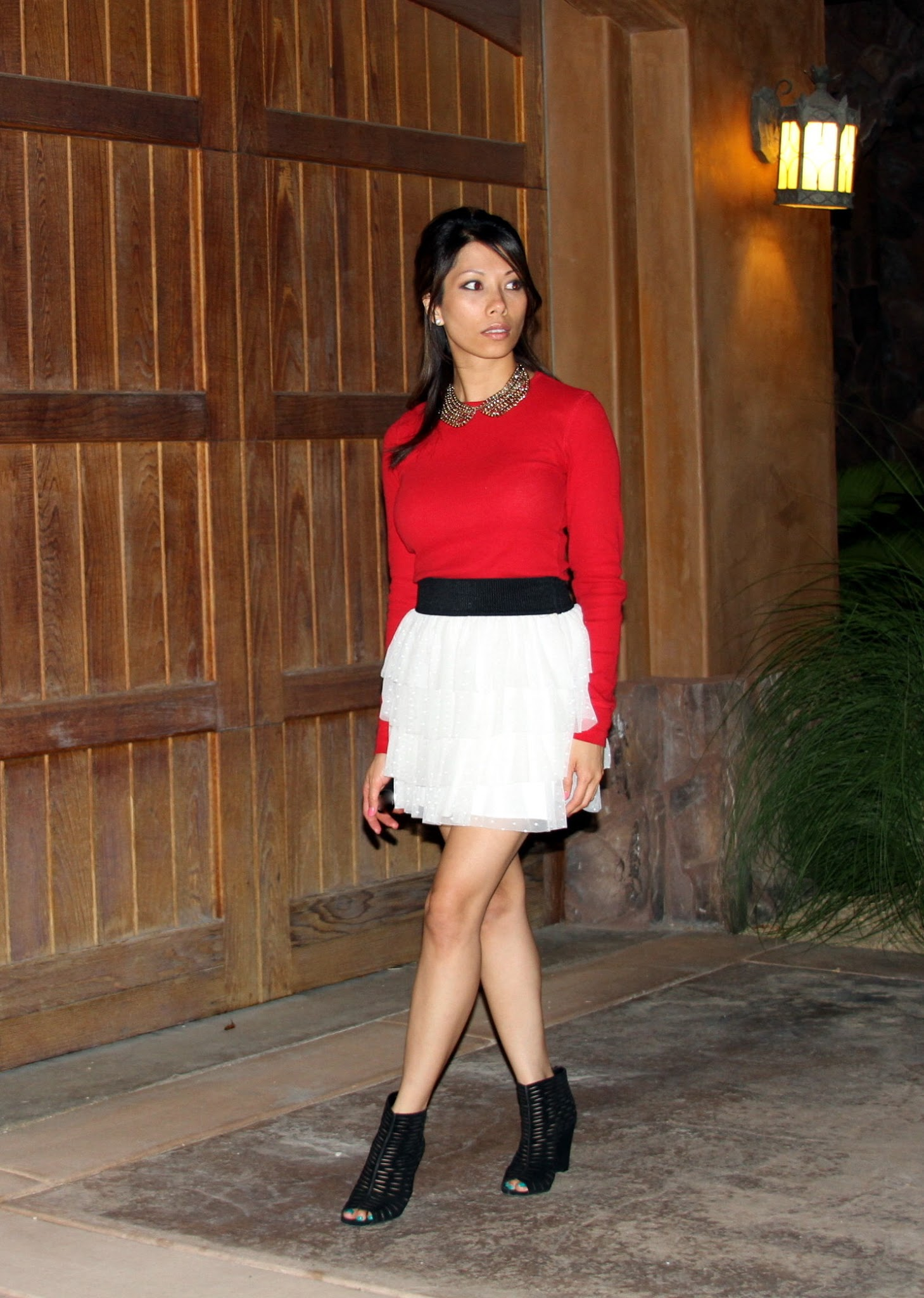 red top and white skirt