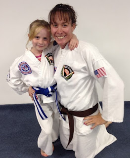 Mother and her daughter doing family martial arts together