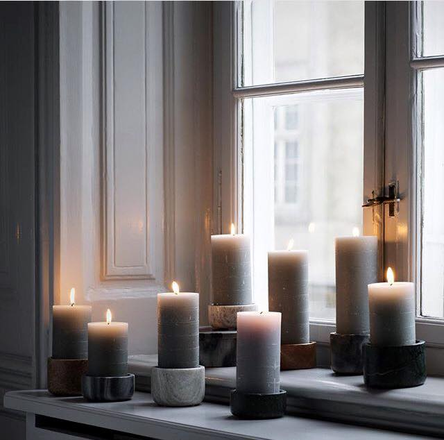 candles in marble candlesticks