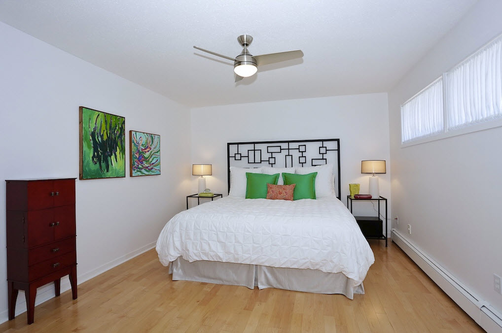 White bedroom with art