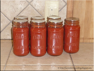 tomato puree in recycled store bought pasta sauce jars