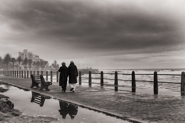 An elderly couple stroll on Cape Town's Seapoint promenade one Sunday in Winter.