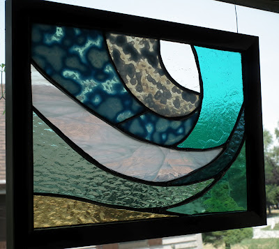 Abstract underwater wave stained glass piece