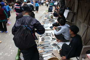 Selling knives at the Sunday market in Hoàng Su Phì
