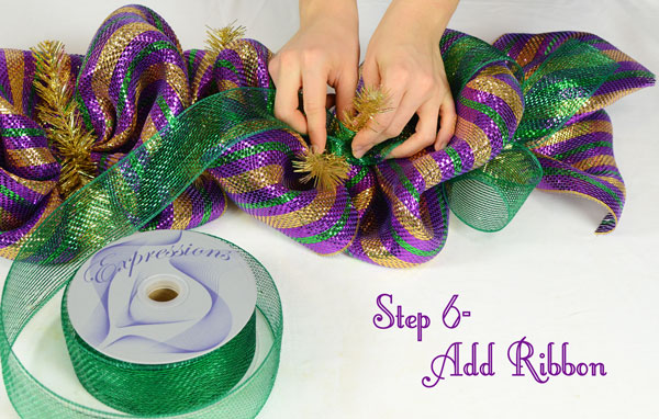Add  deco mesh ribbon to the form along with the Mardi Gras striped deco mesh.