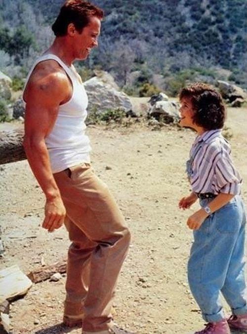 Arnold Schwarzenegger and Alyssa Milano Then & Now Photos