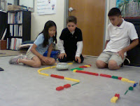 Students testing out their robot program in the maze