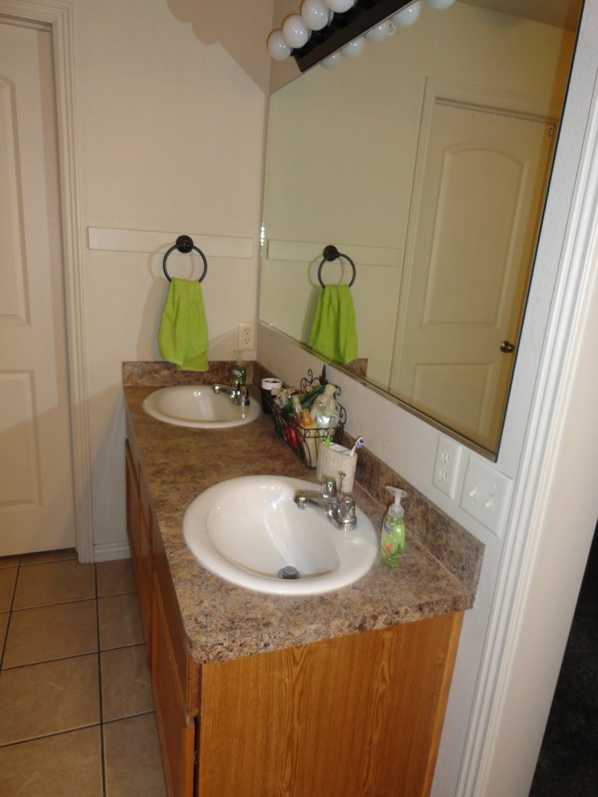 and two sinks, mirrors, and cabinets like this. title=