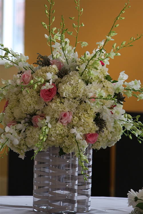hydrangeas, roses, brunia, and other flowers table centerpiece
