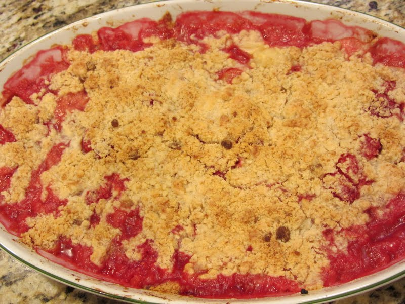 Bubbling stone fruit and berries topped with a buttery crumble topping