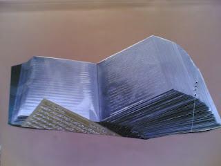 المصحف الشريف محفورا على ألواح الألمونيوم - لأول مرة فى تاريخ كتابة القرأن الكريم