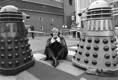1972:  Dr Who, played by Jon Pertwee (1919 - 1996) sits in the car park of the BBC guarded by two Daleks, robotic creatures from the popular tv series.  (Photo by Express/Express/Getty Images)