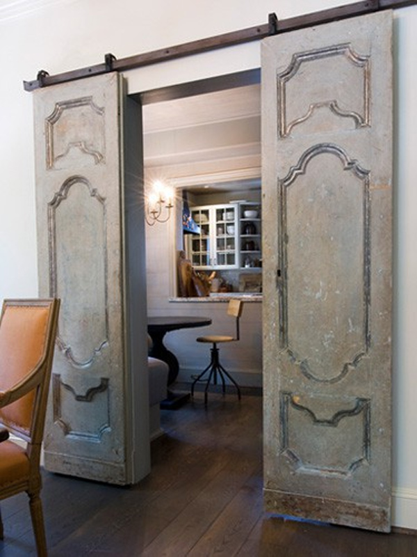 Another example of using vintage doors as sliding pocket doors. Perfection!  Creative Homebody - Marie Flanigan Interiors