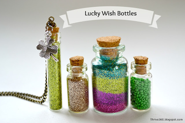 Miniature glass bottles filled with glitter and beads for wish making.