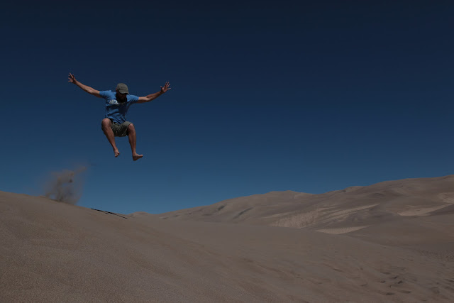 A big jump in the sand at Great Sand Dunes National Park.