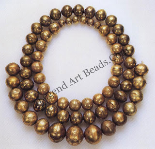 Beads made of hollow gold balls by Chimu craftsmen. Two identical hemispheres were created by tapping a gold sheet into a deep die or by shaping the beads over a domed wooden form. The two halves were then affixed with organic glue; there is no evidence of soldering.