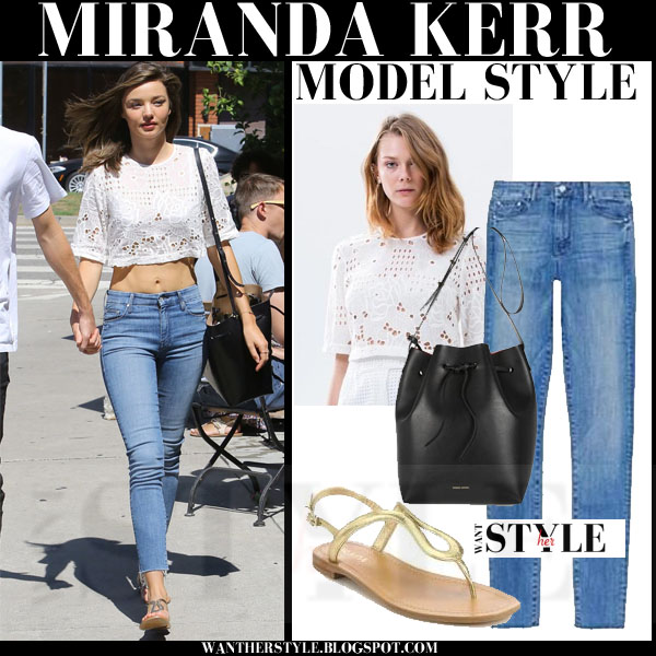 Miranda Kerr in white crochet crop top, blue skinny jeans and gold sandals models off duty streetstyle 2015