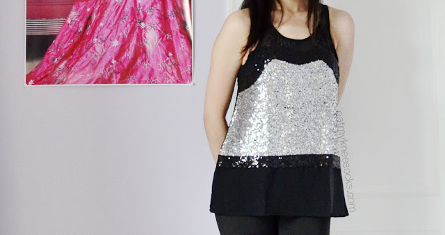 Milanoo's sleeveless sequin-and-mesh top can be dressed up or down and is great for holiday parties.