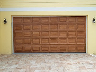 double garage door painted to look like wood.