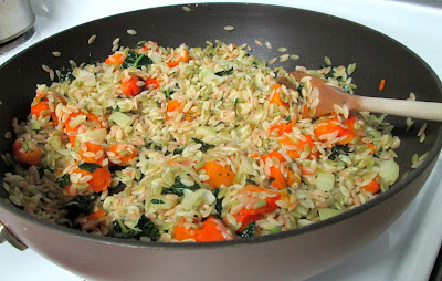 Kale and squash orzo pasta in large skillet