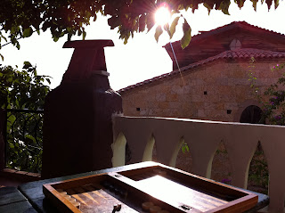 A game of backgammon on the shady balcony next to the Taksiyarhis Church.