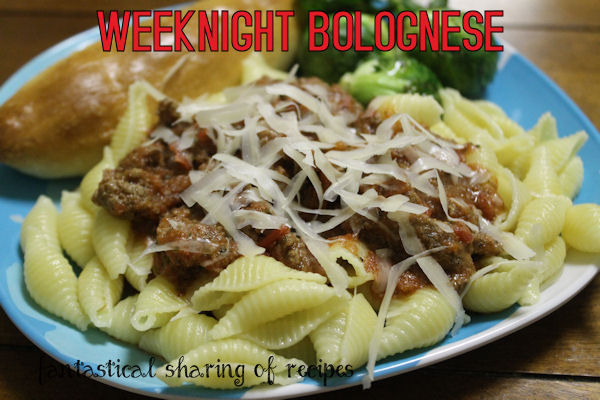 Weeknight Bolognese - a scrumptious red sauce with a hint of nutmeg, served over a heap of pasta #recipe