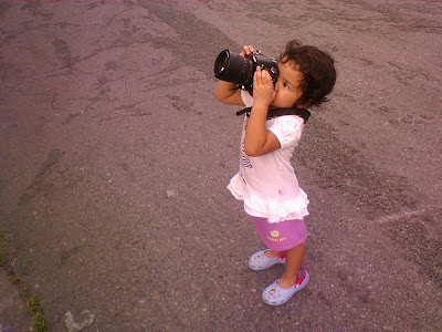 Kecil taking photo with big camera