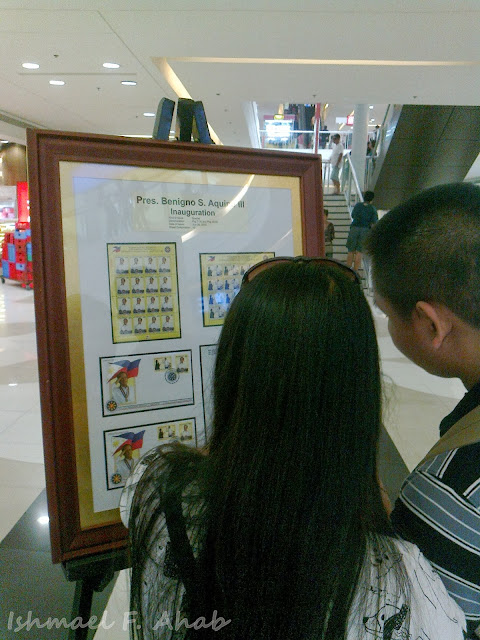 Couple looking at the PhilPost Sulat Mulat exhibit