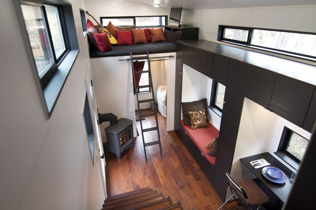 Modern tiny house with wood burning stove