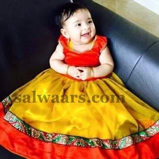 Baby in Rich Mustard Net Lehenga