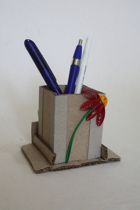 Maya arts and crafts pen stand best out of waste for Best out of waste paper craft