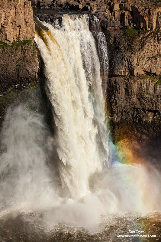 A rainbow forms at the base of Palouse Falls in Palouse Falls State Park, Washington, USA.