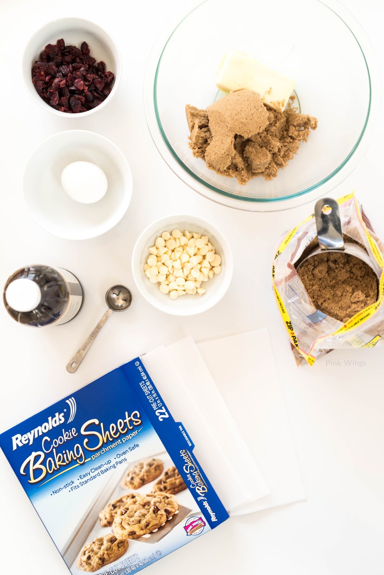 cookie exchange recipes, holiday cookies, easy christmas cookies, craisins, dried cranberries, cranberry desserts, brown sugar cookies, reynolds cookie baking sheets, how to spend less time in the kitchen, white chocolate, cookie gift box, cookies gifts, california food blogger, san francisco bay area, mormon lds, ingredients photography, minimalism, minimalistic photographer, white background,