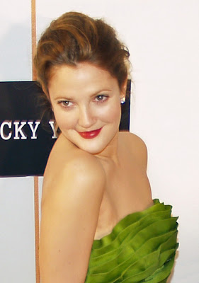 Drew Barrymore in a green dress baring her shoulders