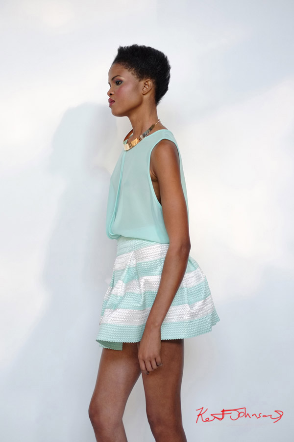 Gold neck band, peppermint green blouse, and stripped skirt. Daylight studio, modelling portfolio Sydney.