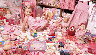 Child with plenty of toys - pink world