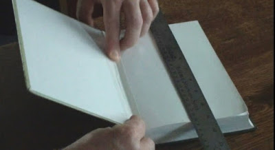 fixing a book with 3M tape