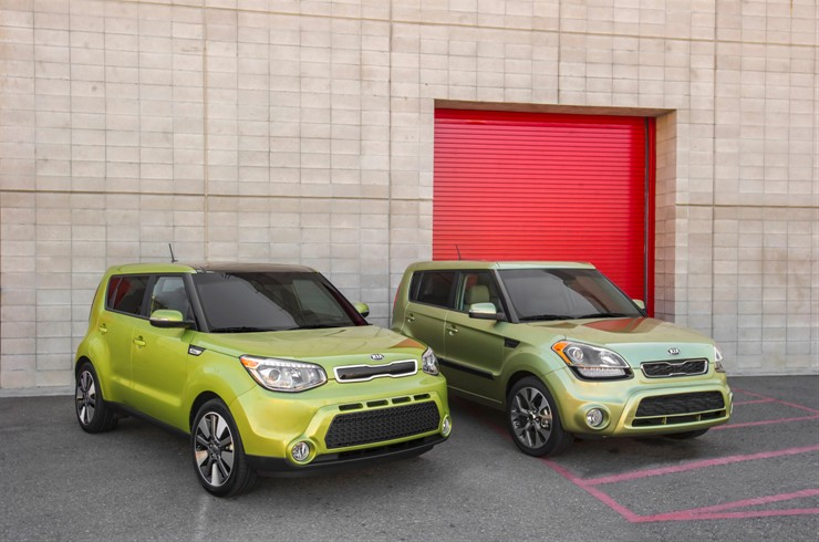 Second Generation Kia Soul next to a First Generation Soul