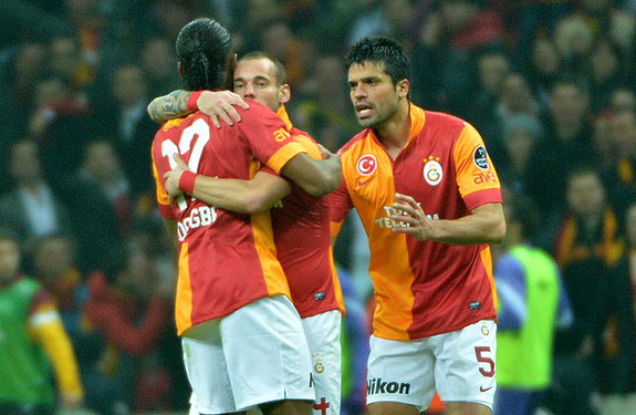 Galatasaray player Wesley Sneijder celebrates with teammates after scoring against Orduspor