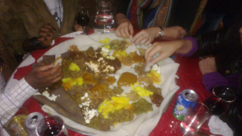 communal eating with hands at the abyssinia restaurant